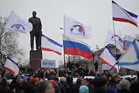 Pro-russian demonstrators in waive Russian flags under the Lenin statue.  Simferopol, Crimea, Ukraine