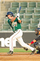 Chase Austin #8 of the Greensboro Grasshoppers follows through on his swing against the Kannapolis Intimidators at Fieldcrest Cannon Stadium August 2, 2010, in Kannapolis, North Carolina.  Photo by Brian Westerholt / Four Seam Images