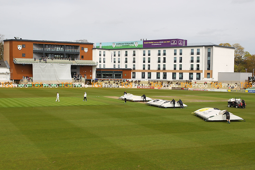 The covers come on ahead of approaching rain during Worcestershire CCC vs Essex CCC, Specsavers County Championship Division 2 Cricket at New Road on 1st May 2016