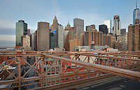 View of the skyscrapers of Downtown Manhattan from Brooklyn Bridge, which spans the East River, connecting Manhattan and Brooklyn, designed by John Augustus Roebling and opened in 1883, in New York, New York, USA. It was the first steel-wire suspension bridge constructed and one of the oldest bridges in the US. Picture by Manuel Cohen