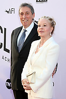 HOLLYWOOD, CA - JUNE 7: Ivan Reitman and Genevieve Reitman at the American Film Institute Lifetime Achievement Award Honoring George Clooney at the Dolby Theater in Hollywood, California on June 7, 2018. <br /> CAP/MPI/DE<br /> &copy;DE//MPI/Capital Pictures