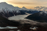 Spring landscape aerial view of snow-covered Chugach Mountains with fog in valley in southcentral Alaska  <br /> <br /> (C) Jeff Schultz/SchultzPhoto.com ALL RIGHTS RESERVED