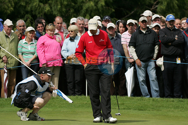 Padraig Harringtons caddy lines up his putt on the 9th green during the final round of the Irish Open on 20th of May 2007 at the Adare Manor Hotel & Golf Resort, Co. Limerick, Ireland. (Photo by Eoin Clarke/NEWSFILE)
