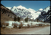 View from the main road of area west of Telluride which is in the distance as we are looking east.<br /> Telluride, CO  Taken by August, Irving - 4/15/1949