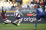 Rodrigo Palacio of Bologna crosses the ball as he is challenged by Nicolas Nkoulou of Torino FC during the Serie A match at Stadio Grande Torino, Turin. Picture date: 12th January 2020. Picture credit should read: Jonathan Moscrop/Sportimage