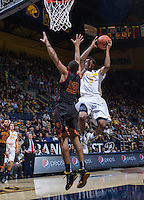 California's Tyrone Wallace shoots over USC's Julian Jacobs for the basket at Haas Pavilion in Berkeley, California on February 23th, 2014. California defeated USC 77 - 64