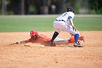 Philadelphia Phillies Johan Rojas (33) slides into second base as Carlos Irigoyen (43) covers the bag during an Instructional League game against the Detroit Tigers on September 19, 2019 at Tigertown in Lakeland, Florida.  (Mike Janes/Four Seam Images)