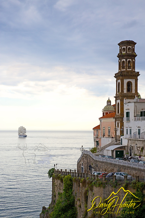 Tall ship leaving Almafi Coast at Atrani Italy