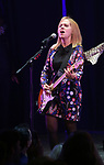 The Go-Go's: Charlotte Caffey performs during a special curtain call at Broadway's 'Head Over Heels' on July 12, 2018 at the Hudson Theatre in New York City.