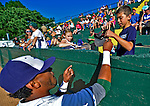 8 July 2012: Vermont Lake Monsters infielder Miguel Marte signs an autograph for a young fan prior to a game against the State College Spikes at Centennial Field in Burlington, Vermont. The Lake Monsters rallied from a 2-0 late inning deficit, to defeat the Spikes 8-2 in NY Penn League action. Mandatory Credit: Ed Wolfstein Photo