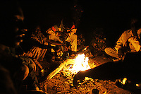 SLA (sudan liberation army) rebels have aa late meal around the fire during the Ramadan in north darfur on Nov 2004