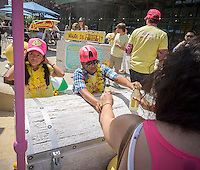 "Volunteers distribute bottles of lemonade for donations to 826NYC at ""Sweet and Sour Chillville"" in Madison Square in New York on Wednesday, August 20, 2014. The 826NYC fundraising event is for the non-profit whose mission is to encourage students ages 8-18 in their writing skills and to promote teachers to inspire students to write. The organization is patterned after a similar one in California and promotes strong writing skills as a pathway to success.   (© Richard B. Levine)"