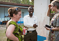Occidental College professor Mary Beth Heffernan talks with Dr. Jerry Brown at ELWA Hospital in Monrovia, Liberia on Tuesday, Feb. 24, 2015. Professor Heffernan is meeting with Dr. Brown to discuss plans for her PPE Portrait project. Dr. Brown was featured on the December 2014 cover of Time magazine as one of the Persons of the Year for his work during the Ebola outbreak in West Africa.<br /> (Photo by Marc Campos, Occidental College Photographer) Mary Beth Heffernan, professor of art and art history at Occidental College, works in Monrovia the capital of Liberia, Africa in 2015. Professor Heffernan was there to work on her PPE (personal protective equipment) Portrait Project, which helps health care workers and patients fighting the Ebola virus disease in West Africa.<br />