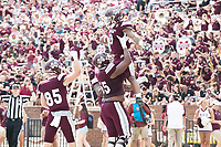 Touchdown celebration during Maroon and White game.<br />  (photo by Beth Wynn / &copy; Mississippi State University)