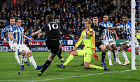 Burnley's Ashley Barnes has his shot saved by Huddersfield Town's goalkeeper Jonas Lossl<br /> <br /> Photographer Andrew Kearns/CameraSport<br /> <br /> The Premier League - Huddersfield Town v Burnley - Wednesday 2nd January 2019 - John Smith's Stadium - Huddersfield<br /> <br /> World Copyright © 2019 CameraSport. All rights reserved. 43 Linden Ave. Countesthorpe. Leicester. England. LE8 5PG - Tel: +44 (0) 116 277 4147 - admin@camerasport.com - www.camerasport.com