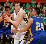 RAPID CITY, S.D. MARCH 20, 2015 -- Gus Reede #4 of Aberdeen Roncalli shields the ball from Shilo Tallman #24 of Little Wound during their semi-final game at the 2015 South Dakota State A Boys Basketball Tournament at the Don Barnett Arena in Rapid City, S.D.  (Photo by Dick Carlson/Inertia)