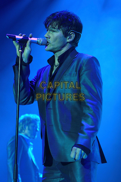 A-HA,  MORTEN HARKET .Perform live in concert at the O2 Arena,.London, England, UK,.4th November 2009..Aha A ha music gig on stage half length black shirt shiny grey gray suit microphone singing side profile .CAP/MAR.© Martin Harris/Capital Pictures.