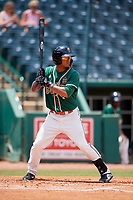 Greensboro Grasshoppers left fielder Jhonny Santos (21) at bat during a game against the Lakewood BlueClaws on June 10, 2018 at First National Bank Field in Greensboro, North Carolina.  Lakewood defeated Greensboro 2-0.  (Mike Janes/Four Seam Images)