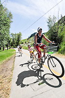 Mother and daughter in tow behind bike on bike path, Steamboat Springs, Colorado