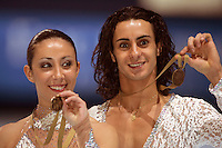 November 19, 2005; Paris, France; Figure skating stars FEDERICA FAIELLA and MASSIMO SCALI of Italy win bronze in ice dancing at Trophee Eric Bompard, ISU Paris Grand Prix competition.  They are one of the favorites for medals in ice dancing leading up to Torino 2006 Olympics.<br />Mandatory Credit: Tom Theobald/ <br />Copyright 2005 Tom Theobald