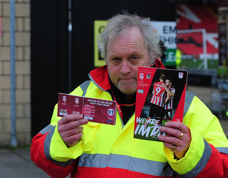 A programme seller with Half Time Draw tickets and programmes<br /> <br /> Photographer Andrew Vaughan/CameraSport<br /> <br /> The EFL Sky Bet League Two - Lincoln City v Grimsby Town - Saturday 19 January 2019 - Sincil Bank - Lincoln<br /> <br /> World Copyright © 2019 CameraSport. All rights reserved. 43 Linden Ave. Countesthorpe. Leicester. England. LE8 5PG - Tel: +44 (0) 116 277 4147 - admin@camerasport.com - www.camerasport.com