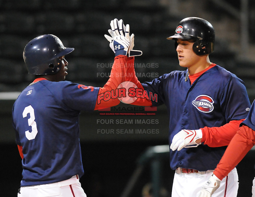 April 7, 2009: Anthony Rizzo of the Greenville Drive is congratulated after hitting a home run in a game against Wofford College on Tuesday, April 7, 2009, at Fluor Field in Greenville. Photo by:  Tom Priddy/Four Seam Images