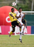 Romario Jones (8) of Jamaica goes up for a header with Romario Piggott (15) of Panama during the third place game of the CONCACAF Men's Under 17 Championship at Catherine Hall Stadium in Montego Bay, Jamaica. Panama defeated Jamaica, 1-0.