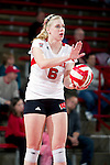Wisconsin Badgers Janelle Gabrielsen (6) prepares to serve during an NCAA volleyball match against the Michigan Wolverines at the Field House on October 30, 2010 in Madison, Wisconsin. Michigan won the match 3-1. (Photo by David Stluka)