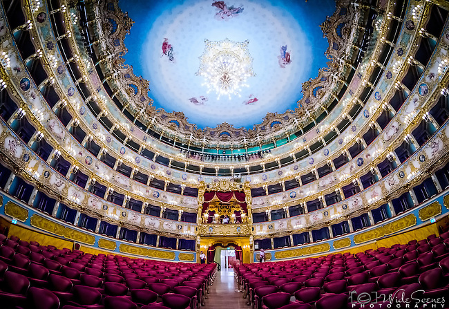 "A fisheye view of the famous La Fenice Theatre in the sestiere of San Marco in Venice, Italy. It is one of the most famous theatres in Europe, the site of many famous operatic premieres. Its name reflects its role in permitting an opera company to ""rise from the ashes"". Since opening and being named La Fenice, it has burned and been rebuilt twice more."