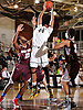 Justin Caldwell #44 of Baldwin, center, leaps between Princeton Louis #23, left, and Donnell Louissaint #13 of Deer Park to pull down a rebound during the penultimate game in the Tip of the Hat Classic at Adelphi University on Sunday, Jan. 10, 2016.