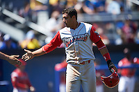 Williamsport Crosscutters outfielder Andrew Amaro (5) high fives a teammate after scoring a run during a game against the Batavia Muckdogs on July 16, 2015 at Dwyer Stadium in Batavia, New York.  Batavia defeated Williamsport 4-2.  (Mike Janes/Four Seam Images)