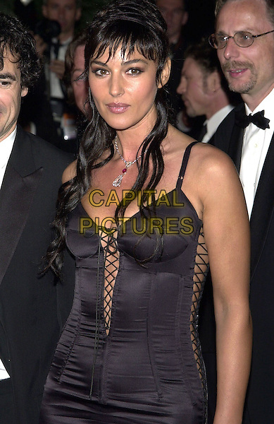 "MONICA BELLUCCI.arriving for her film ""Irreversible"".Cannes Film Festival, France, 24thMay 2002.half length black corset lace up top .Ref: PL.www.capitalpictures.com.sales@capitalpictures.com.©Capital Pictures."