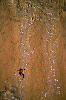 Aerial view of a rock climber as he climbs a sheer rock face. Smith Rock State Park, Oregon.