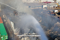 63818-02317 Firefighters extinguishing warehouse fire using aerial ladder truck viewed from top of ladder, Salem, IL