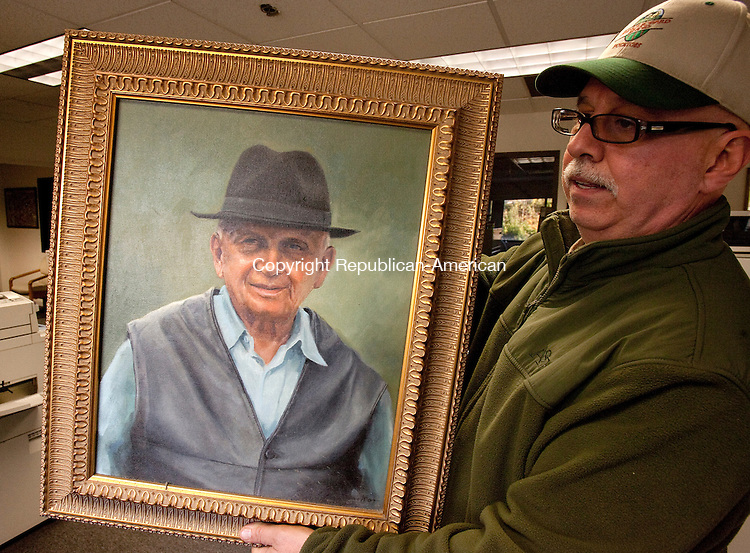 WATERBURY, CT, 21 OCTOBER 2010-102110JS02-Bill Jarjura vice-president of Purchasing at JP Jarjura &amp; Sons in Waterbury, holds a painting of his late father Joseph P. Jarjura who passed away on Thursday at the age of 89.  Joseph was the founder and Chairman of the Board of J.P. Jarjura &amp; Sons Company.<br />  Jim Shannon Republican-American