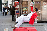 Waiter falling street performer, Madrid, Spain