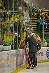 4 January 2014:  The plate arena glass is replaced after University of Vermont Catamount Forward Connor Brickley, a Senior from Everett, MA, charged Yale University Bulldog defenseman Ryan Obuchowski, and shattered the glass with a skate, delaying the game in the second period at Gutterson Fieldhouse in Burlington, Vermont. With an empty net and seconds remaining, the Cats came back to tie the game 3-3 against the 10th seeded Bulldogs. Mandatory Credit: Ed Wolfstein Photo *** RAW (NEF) Image File Available ***