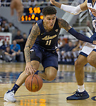 Akron guard Channel Banks (11) drives against Nevada        in the second half of an NCAA college basketball game in Reno, Nev., Saturday, Dec. 22, 2018. (AP Photo/Tom R. Smedes)
