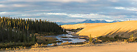 Ahnewetut Creek flows through the Great Kobuk Sand Dunes in the Kobuk Valley National Park, Baird Mountains in the distance, Arctic, Alaska.