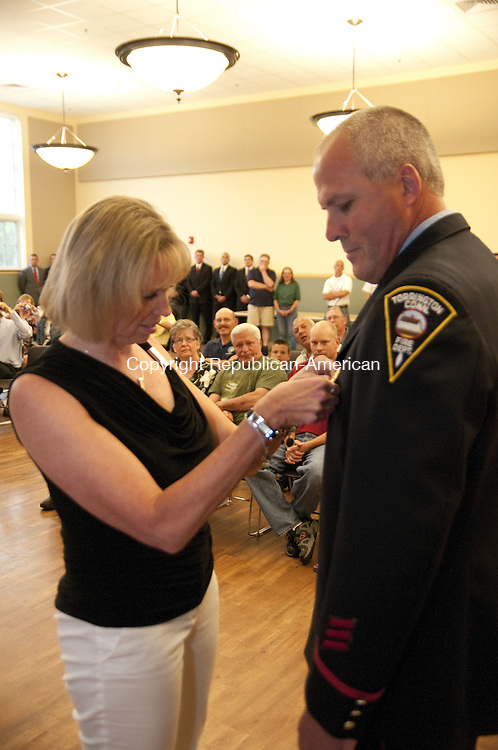 TORRINGTON, CT - 05 JUNE 2014 --Todd LaMothe is pinned by his wife Sheila as he is promoted to lieutennant in the Torrington Fire Department Wednesday.  Alec Johnson/ Republican-American