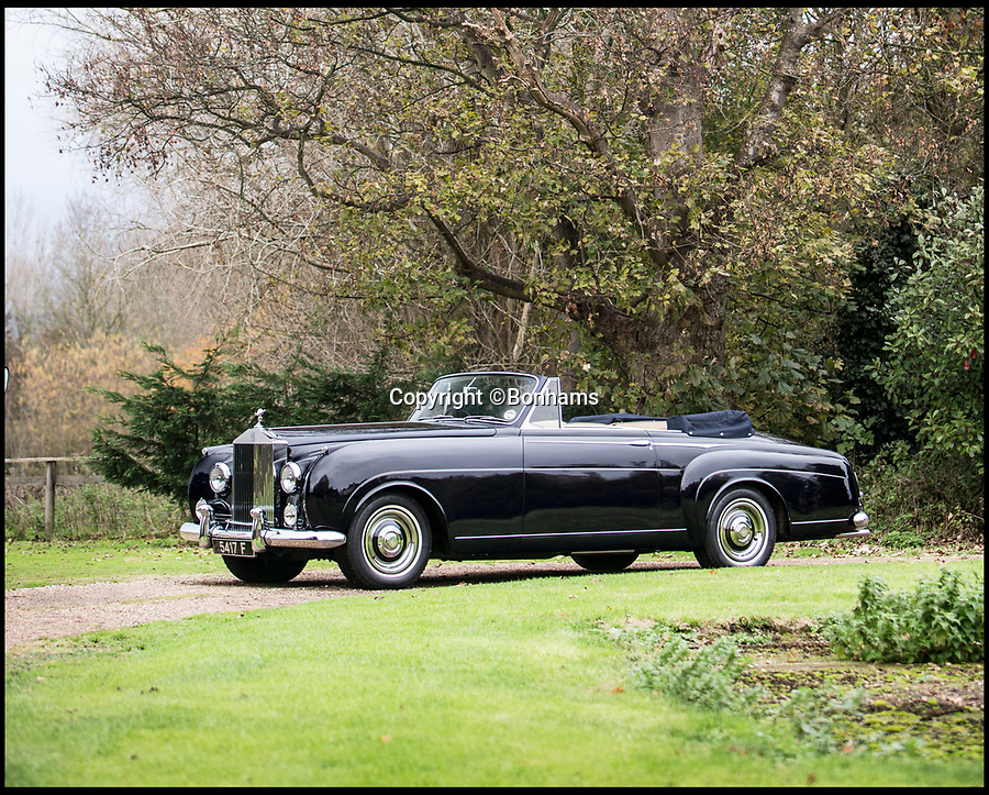BNPS.co.uk (01202 558833)<br /> Pic: Bonhams/BNPS<br /> <br /> 'True Blue' Roller for sale that starred at the wedding of Madonna and Guy Ritchie.<br /> <br /> The Rolls-Royce used during the wedding of Guy Ritchie and Madonna has emerged for sale for £800,000.<br /> <br /> The 1959 Silver Cloud Drophead was involved in the day as it was owned by Peter de Savary, a millionaire entrepreneur who also owned Skibo Castle, in Scotland where the couple tied the knot in 2000.<br /> <br /> The wedding was one of the most closely guarded events of that year with the pair going to extreme lengths to maintain their privacy.<br /> <br /> Guests were instructed to arrive at least three days in advance and were not permitted to use their phones at all while at the castle, while staff were forced to sign confidentiality agreement which was four pages long.