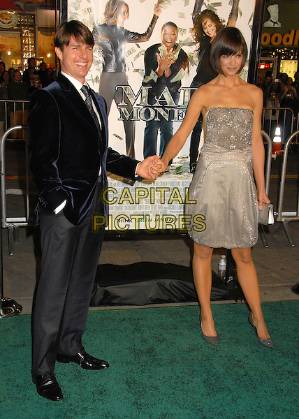 "TOM CRUISE & KATIE HOLMES.""Mad Money"" Los Angeles Premiere at Mann's Village Theatre, Westwood, California, USA..January 9th, 2008.full length blue suit jacket strapless silver dress jewel encrusted married husband wife clutch bag purse grey gray trousers beads beaded holding hands .CAP/ADM/BP.©Byron Purvis/AdMedia/Capital Pictures."