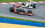 04 Apr 2009, Kuala Lumpur, Malaysia --- Vodafone McLaren Mercedes F1 Team driver Heikki Kovalainen of Finland steers his car followed by Brawn GP Formula 1 Team driver Rubens Barrichelo of Brazil during the third practice session ahead the 2009 Fia Formula One Malasyan Grand Prix at the Sepang circuit near Kuala Lumpur. Photo by Victor Fraile --- Image by © Victor Fraile / The Power of Sport Images