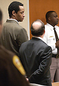 Convicted sniper John Allen Muhammad, left, looks over to his attorney Peter Greenspun, as the jury recommendation of death is read at the Virginia Beach Circuit Court in Virginia Beach, Virginia on Monday November 24, 2003. <br /> Credit: Davis Turner - Pool via CNP
