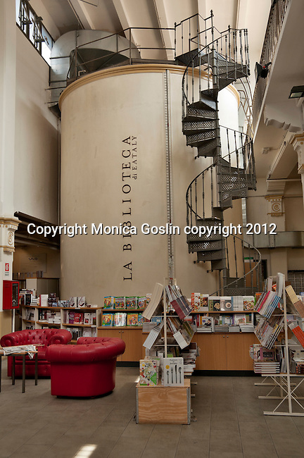 The library and bookstore at Eataly, the high end Italian food market in Turin, Italy which is where the company started and where it occupies a building that used to be a vermouth factory