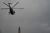 Marine One, with United States President Donald J. Trump aboard, departing from the White House into rainy skies on September 17th, 2020 in Washington, DC.  The President is scheduled to travel to Mosinee, Wisconsin for a campaign event before returning to Washington, DC.<br /> Credit: Alex Edelman / Pool via CNP