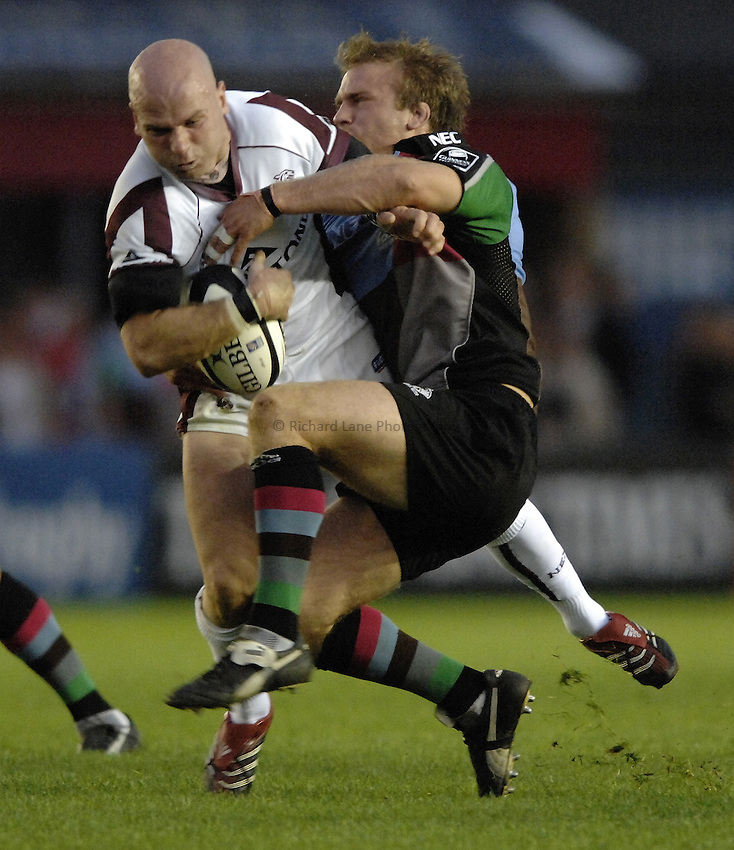 Photo: Richard Lane..NEC Harlequins v Leicester Tigers. Guinness Premiership. 23/09/2006. .Tigers' Paul Burke is tackled by Will Skinner.