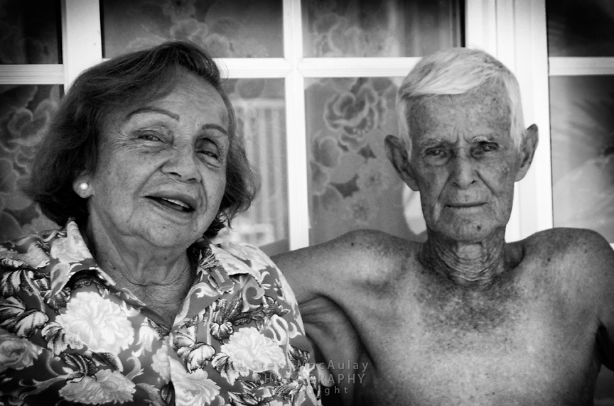 Old Panamanian couple on porch, Panama City, Panama
