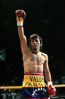 "IEdwin Valero of Venezuela celebrates his victory against Mexican Héctor Velazquezfor the World-wide Council of Box (CMB), in Caracas,  December 20th 2009.Valero, famed for an impressive record of 27 straight knockouts and a huge tattoo of Chavez on his chest, hanged himself in his jail cell last week. The boxer, who was nicknamed ""El Inca"" in reference to an Indian warrior, committed suicide a day after he was arrested for murdering his 24-year-old wife."