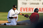 SIOUX FALLS, SD - JUNE 11:  Jake Taylor #8 from the Sioux Falls Canaries tries to put the tag on David Espinosa #7 from the Lincoln Saltdogs on a stolen base attempt in the third inning Tuesday night at the Sioux Falls Stadium.  (Photo by Dave Eggen/Inertia)